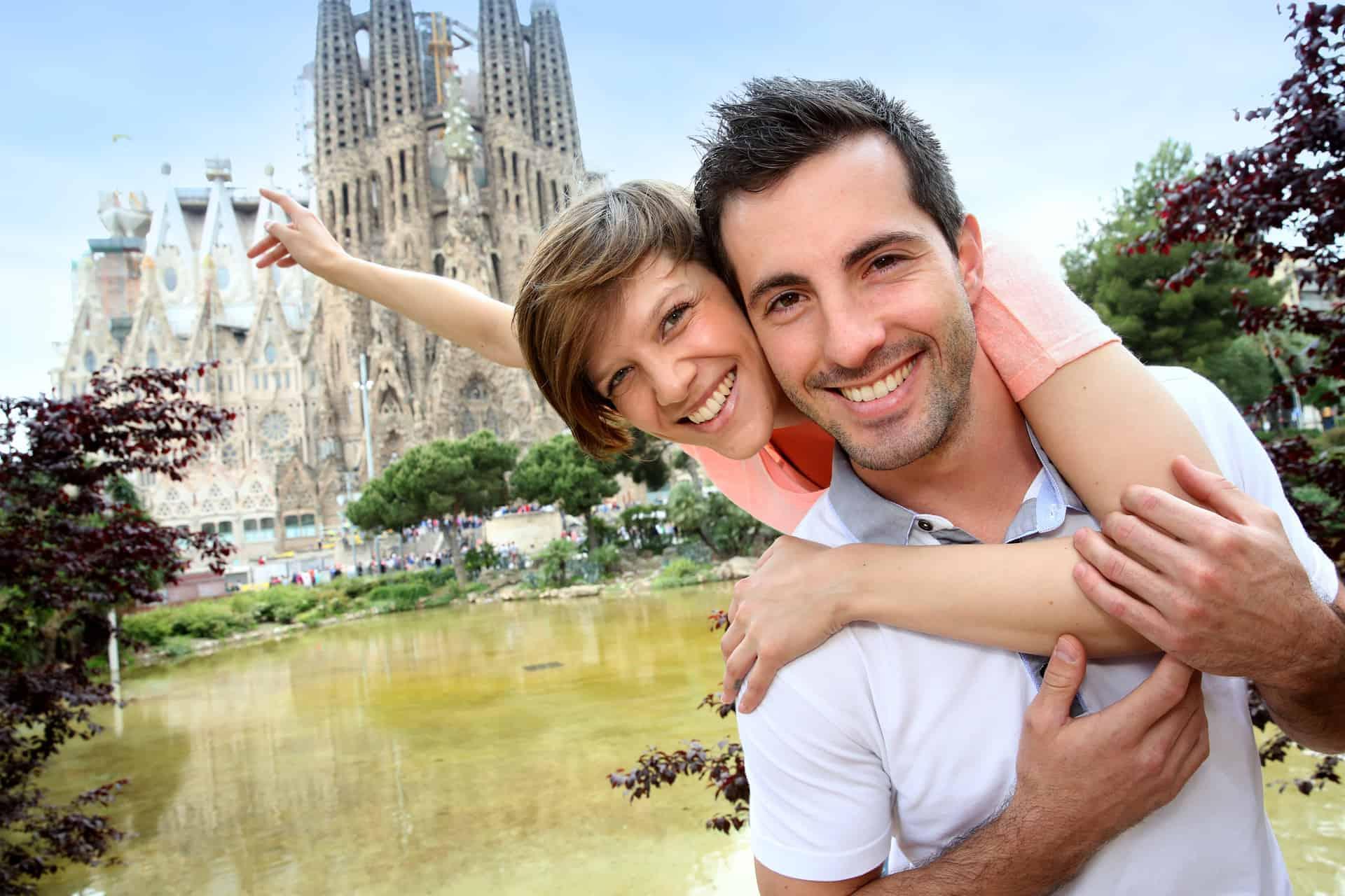 Couple In Front Of Sagrada Familia
