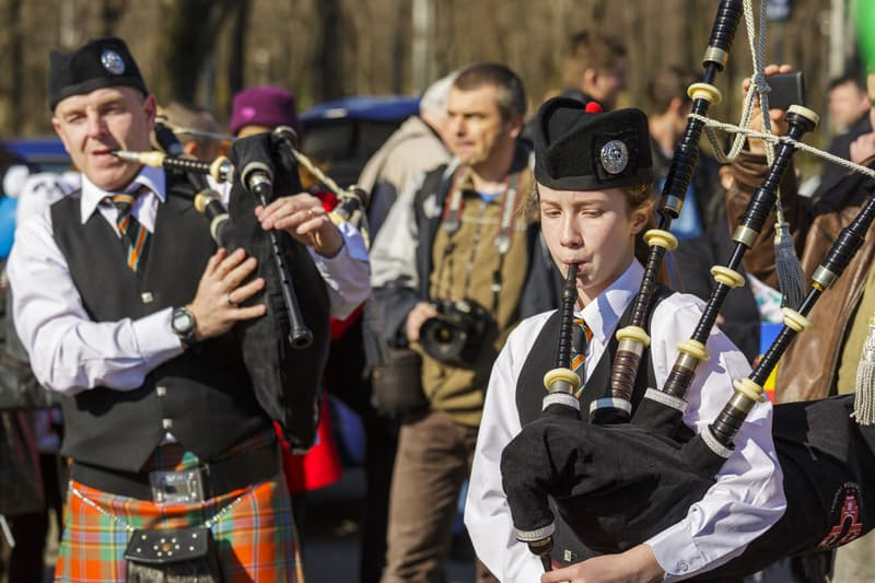 Irish Bagpipe Band Playing On The Streets